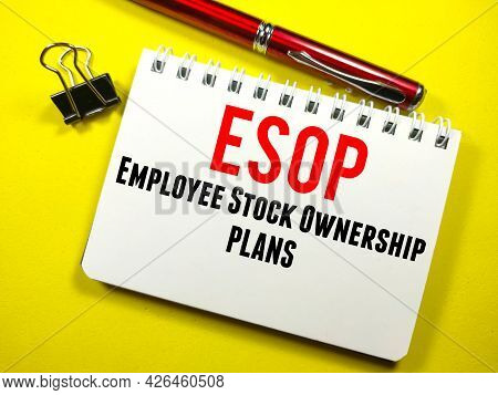 Business Concept.text Esop (employee Stock Ownership Plans) On Notebook With Paper Clips And Pen On
