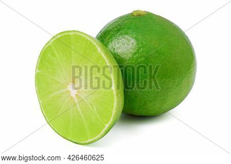 Isolated Lime. Natural Fresh Lime With Slices Isolated On White Background. With Clipping Path.