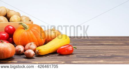 Autumn Harvest. Assortment Of Fresh Organic  Vegetables On Wooden Table With Copy Space. Banner.