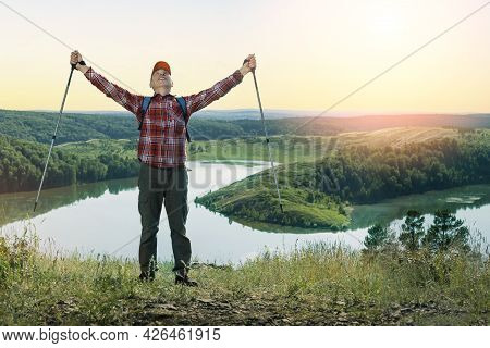 Happy Hiker With Her Arms Outstretched, Freedom And Happiness In Mountains At Sunset.