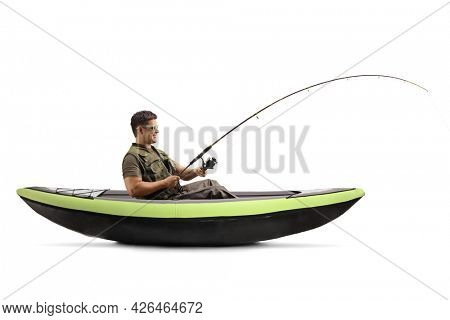 Side shot of a young man catching fish from a canoe isolated on white background