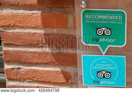 Toulouse , Ocitanie France  - 06 30 2021 : Tripadvisor Logo Brand And Sign Text On Windows Front Of