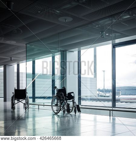 Wheelchairs in a modern airport. Wheelchairs ready for use by passangers with disabilities