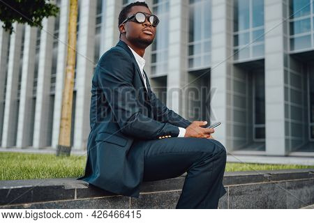 Successful Businessman Of African Descent With Mobile Phone