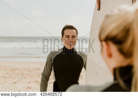 Surfers talking at the beach