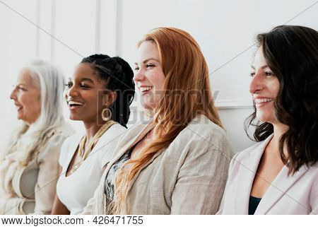 Happy gorgeous women standing together