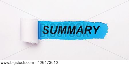 On A Bright Blue Background, White Paper With A Torn Stripe And The Text Summary