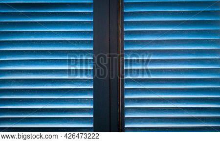 Blue door and window  with shutters