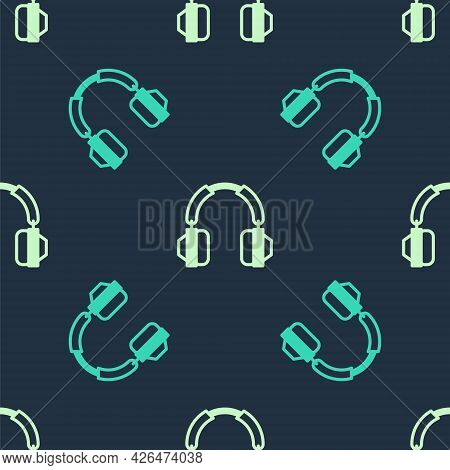 Green And Beige Headphones Icon Isolated Seamless Pattern On Blue Background. Earphones. Concept For