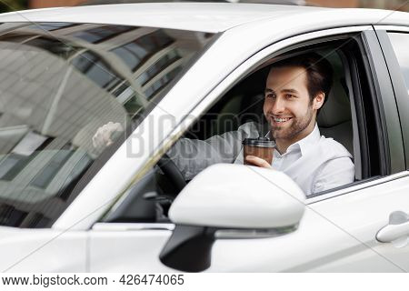 Coffee And Drive, Businessman Sitting At Car Driving And Drinking Coffee To Go