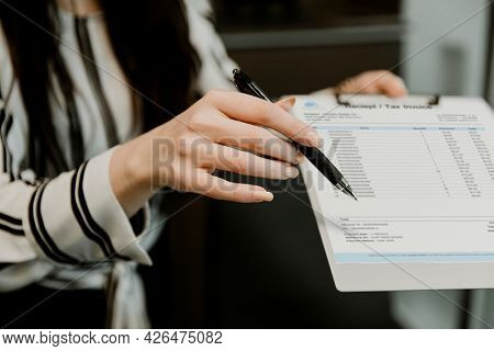 Office worker showing the receipt and tax invoice to the customer
