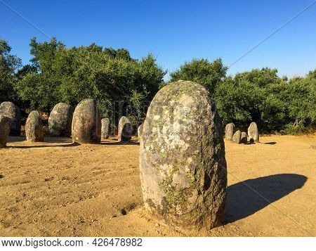Close Up Of Neolithic European Megalith That Casts A Late Summer, Golden Hour Shadow. Rows Of Megali