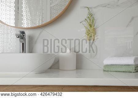 Silicone Vase With Flowers On White Marble Wall Over Countertop In Stylish Bathroom