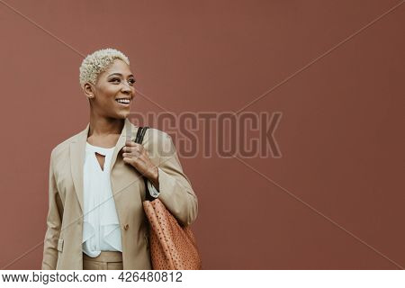 Happy black businesswoman strolling the streets