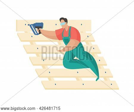 Man With Nail Gun. Quick Connection Planks And Wooden Planks. Uniformed Craftsman Fixes Bed Frame. P