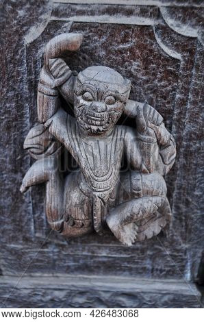 Wooden Figure Deity Carving Of Teakwood Temple Of Mandalay Or Shwenandaw Monastery Or Golden Palace