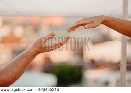 Hand Reach For Each Other. Romantic Relationships And Family Understanding.