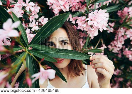 Beautiful woman portrait in flowers. Beauty Woman face flowers Portrait flowers. Beautiful model woman flowers portrait. Woman smiling portrait on flowers background. Beautiful woman smiling in flowers. Woman portrait with bouquet of flowers. Woman face f