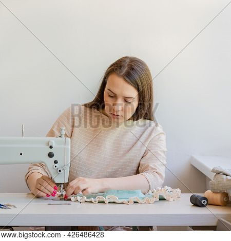 Young Concentrated Woman Sewing New Clothing At Her Own Fashion Atelier, Professional Seamstress Mak