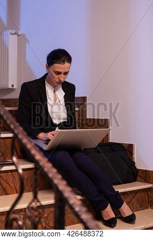 Stressed Exhausted Businesswoman Working On To Finish A Business Job Deadline At Late Hours. Serious