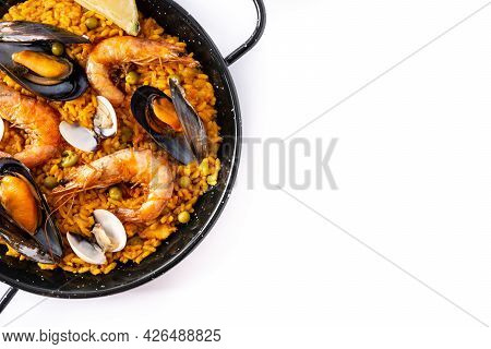 Traditional Spanish Seafood Paella Isolated On White Background. Top View. Copy Space