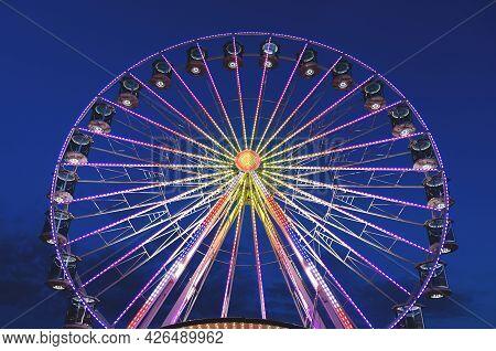 High Ferris Wheel Against Dark Night Sky In Our Summer Vacation At Adriatic Seaside. Amusement Park