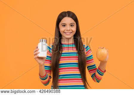 Get Strong Eat Vitamins. Happy Child Hold Apple And Supplement Bottle. Apple Supplement