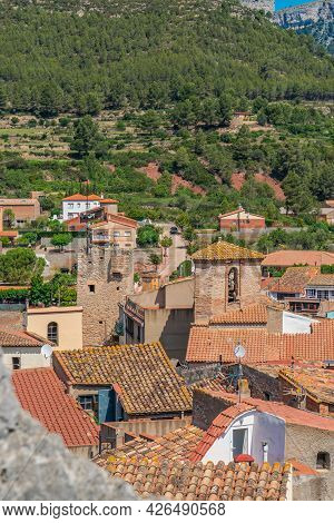 Roofs Of Old Houses With A Church Tower At Pratdip, Catalunya Spain. Background Forest At The Mounta