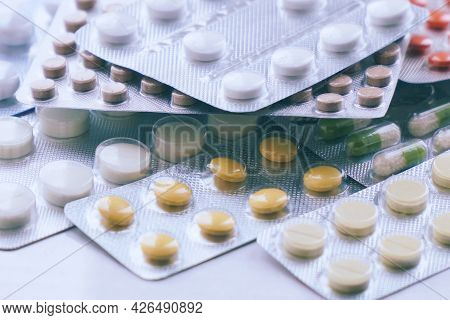 Overall View Of Pharmaceutical Tablets And Capsules In Packages In Assortment. Tablets In A Blister