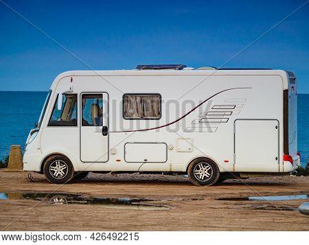 Caravan Vehicle Camping On Mediterranean Coast In Spain. Vacation In Motorhome.