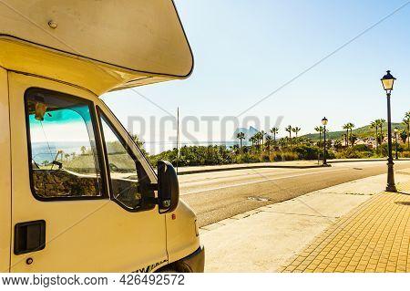 Caravan Rv On Mediterranean Coast In Spain. Gibraltar Rock On Horizon. Roadtrip, Vacation In Mobile
