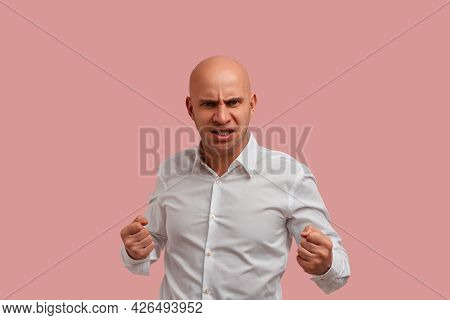 Ready To Fight. Displeased Annoyed Bald Man With Bristle In White Shirt, Have Eyes Full Of Hate, Cle