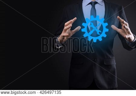 Businessman Holding Gear Icon With Tools.gearing.concept Of Target Focus Digital Diagram,graph Inter