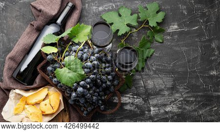 Red Wine Bottle Cheeses Grapes Pair Of Wine Glasses. Vintage Still Life Wine Composition With Aged C