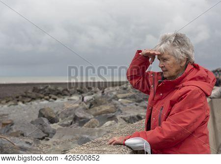 Senior Woman In Eighties Outdoors Looking At View