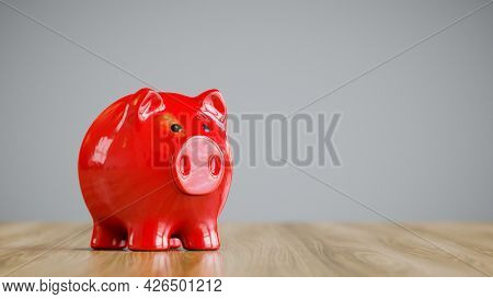 A typical red piggy bank with text space. 3d illustration