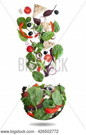Fresh Ingredients Falling Into A Salad Bowl Shape