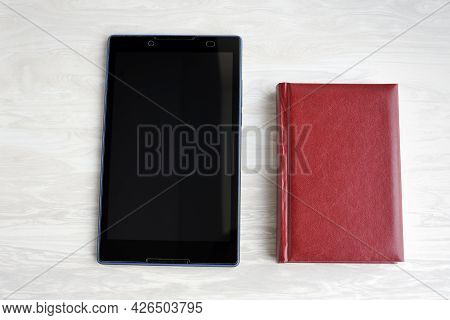 Classic Paper Book And Modern Electronic Reader. New Way For Reading Digital E-books, Display Text A