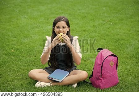 Food For Healthy Tooth. Little Kid Eat Apple Sitting On Green Grass. School Snack. Health Education.
