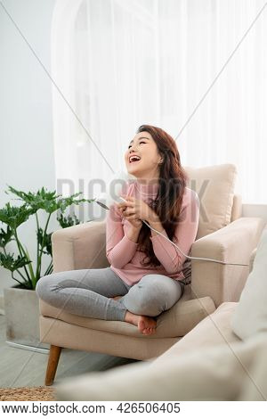 Photo Of Smiling Woman With Long Dark Hair And Healthy Skin Drying Her Hair