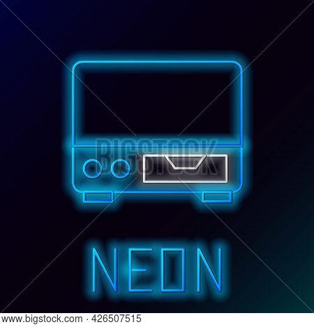 Glowing Neon Line Old Video Cassette Player Icon Isolated On Black Background. Old Beautiful Retro H