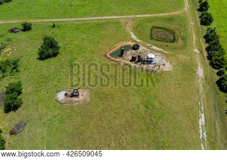 Aerial View In Oil Well Pump Jack Working Pump Jack Out In Field Of Grass With Of Oklahoma Us