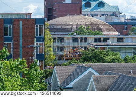New Orleans, La, - July 1: Crew Of Construction Workers Amidst A Diversity Of Rooftops At Tulane Uni