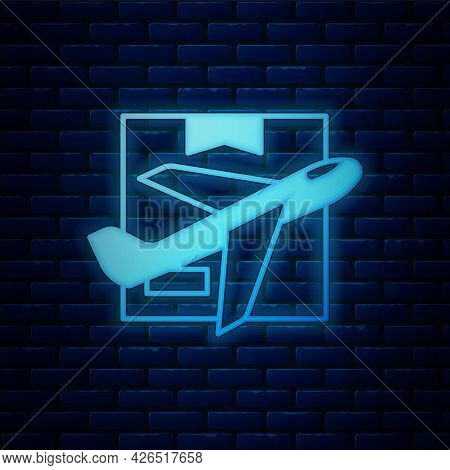 Glowing Neon Plane And Cardboard Box Icon Isolated On Brick Wall Background. Delivery, Transportatio