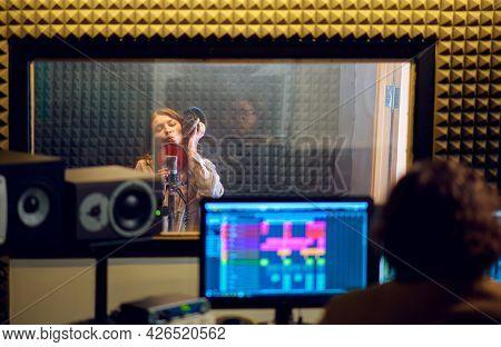 Male musician and female singer, recording studio