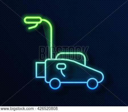 Glowing Neon Line Lawn Mower Icon Isolated On Blue Background. Lawn Mower Cutting Grass. Vector