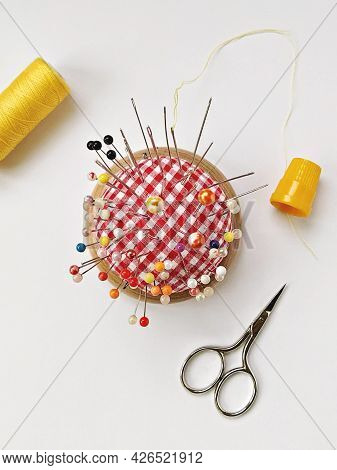 Round Pin Cushion With Lot Of Pins, Yellow Thimble, Spool Of Thread And Scissors. Sewing Accessories