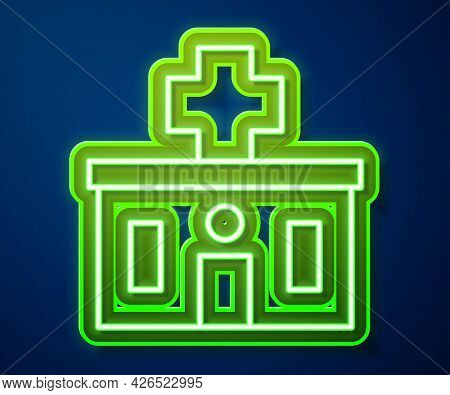 Glowing Neon Line Medical Hospital Building With Cross Icon Isolated On Blue Background. Medical Cen