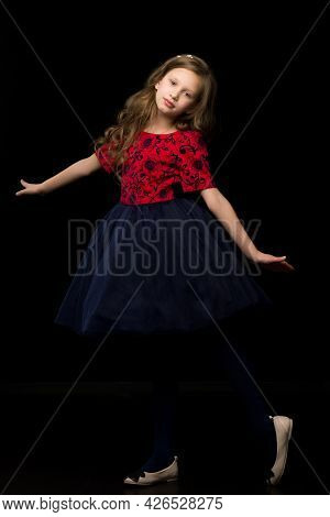 Beautiful Blonde Girl Wearing Nice Tutu Dress Standing Standing On One Leg And Looking To The Side,