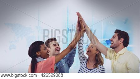 Composition of network of digital icons over people high fiving. global business, digital interface, technology and networking concept digitally generated image.